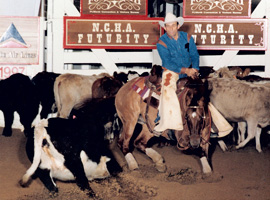 Photo of Lynn cutting cattle with his cutting horse
